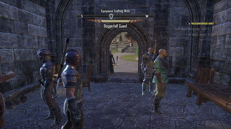 Screenshot from Elder Scrolls Online, looking towards the entrance to an interior crafting area with guards and NPCs visible in Daggerfall.