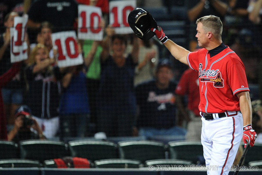 Chipper Jones waves at fans during his last season.