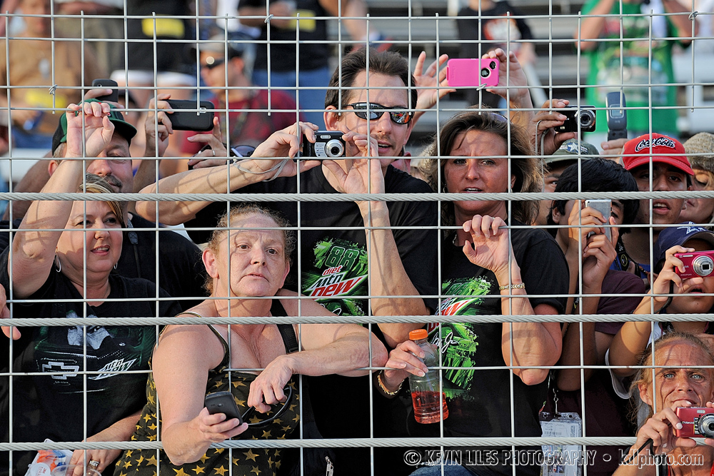 Fans of NASCAR Sprint Cup Series driver Dale Earnhardt Jr. try to get a glimpse of him at Atlanta Motor Speedway.