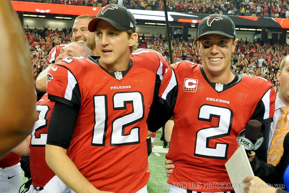 Falcons quarterbacks Luke McCown (12) and Matt Ryan celebrate the win.