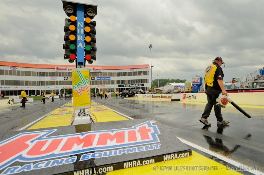 nhra worker cleans up track