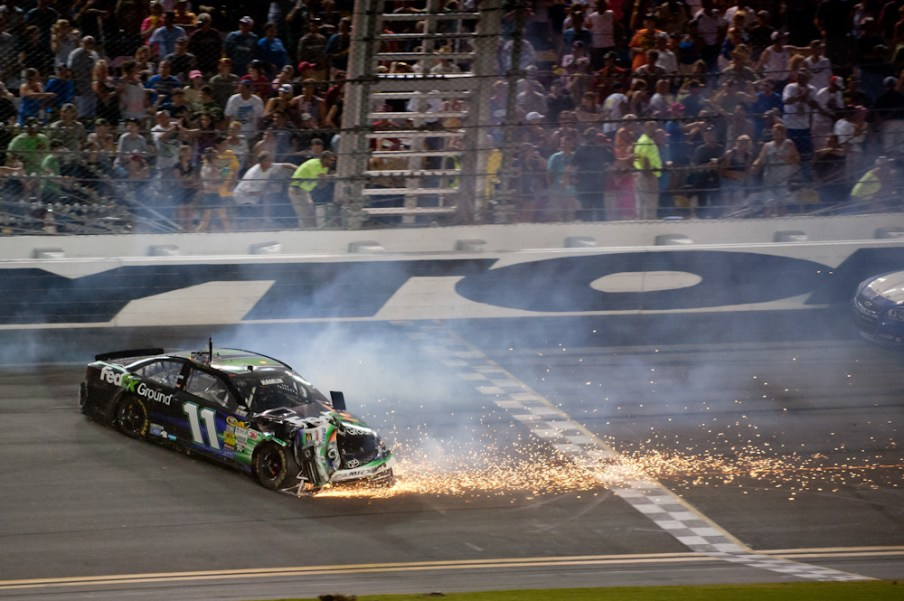 NASCAR Sprint Cup Series driver Denny Hamlin (11) crashes during the Coke Zero 400 at Daytona International Speedway.