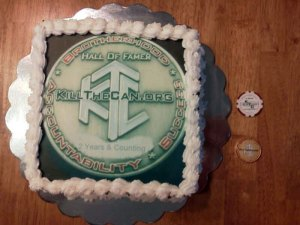 A cake made with the design of the KillTheCan.org HOF coin on it