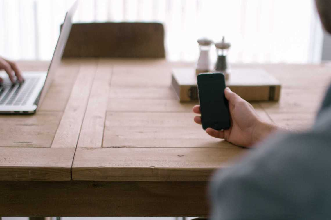 person smartphone office table Contact - 1