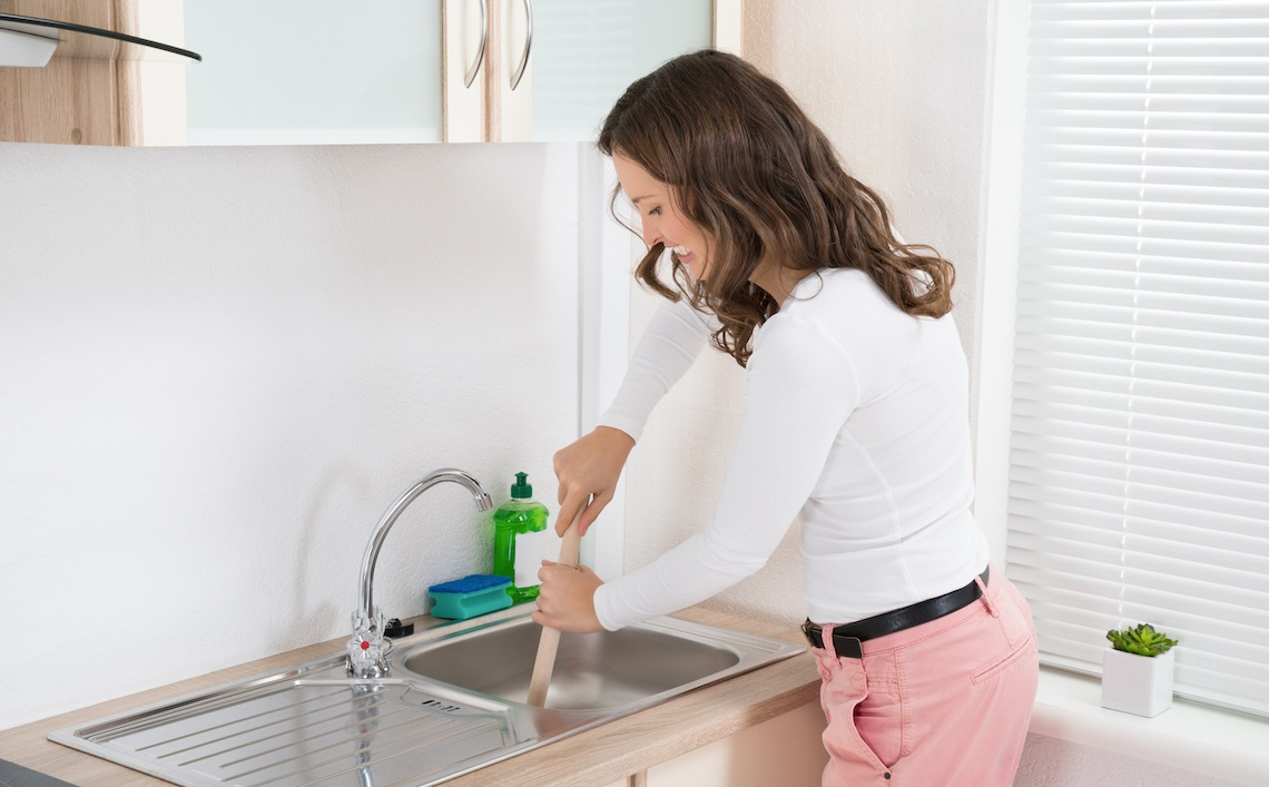 how to unclog a kitchen sink without