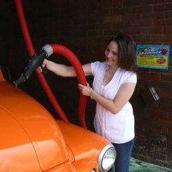 customer using air dryer on car