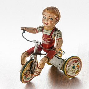 vintage mechanical tin toy riding Tricycle