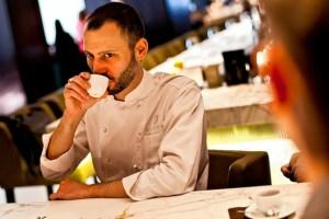 Gabriel Kreuther tasting La Colombe Haitian Blue coffee.