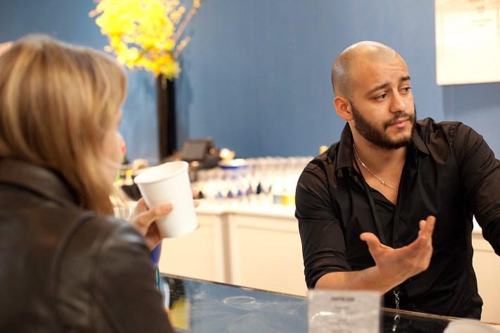 Hamza talking to an art enthusiast