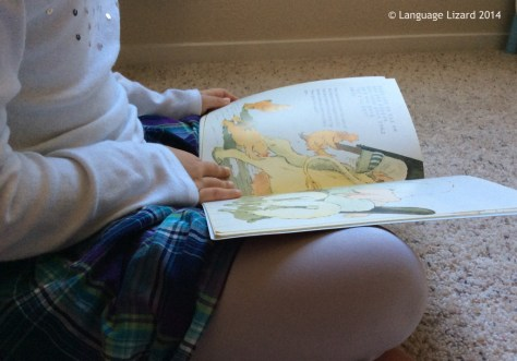 kid reading bilingual book