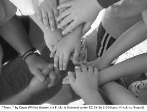 classroom community hands together teamwork multicultural bilingual language