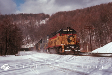 Sunshine, snow, and Chessie 4162 at Salt Lick Curve west of Terra Alta, West Virginia.