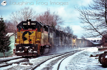 It's partly cloudy in Terra Alta as Chessie System GP40-2 4162 leads an eastbound coal drag on 2/21/1988.