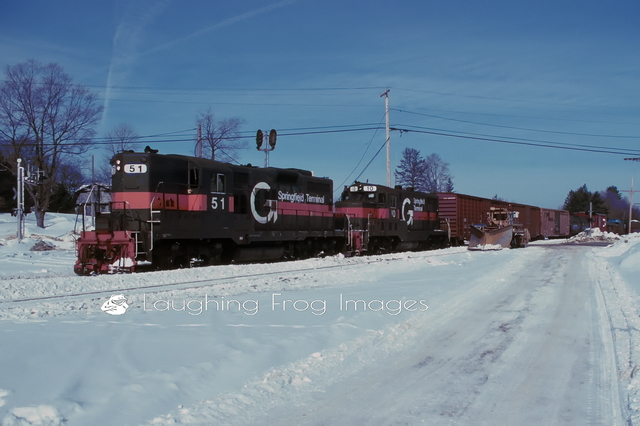 Guilford Rail System (Maine Central) train SDPO is heading west through Danville Junction, ME. The train originated at the S. D. Warren paper mill in Hinckley, ME and is headed to Rigby Yard in Portland, ME. It's February of 1994. GP-9 51 is the youngster here at 37 years old, while GP-7 10 is a proud 41!