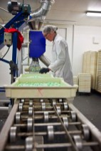 Tommy Bennet handles quality control and tray packs.