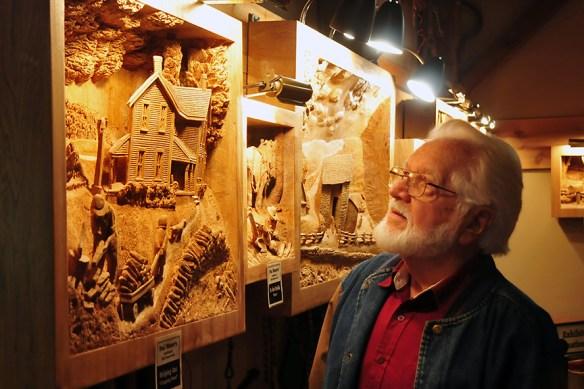 Jay Lehman Viewing Weaver's Carvings