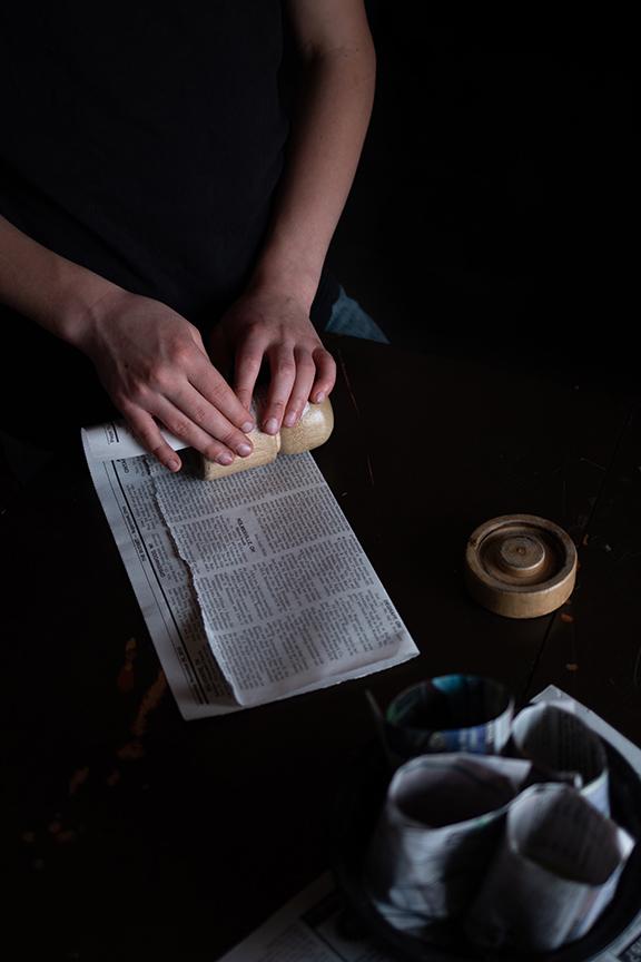rolling newspaper
