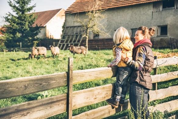 mom and girl on farm
