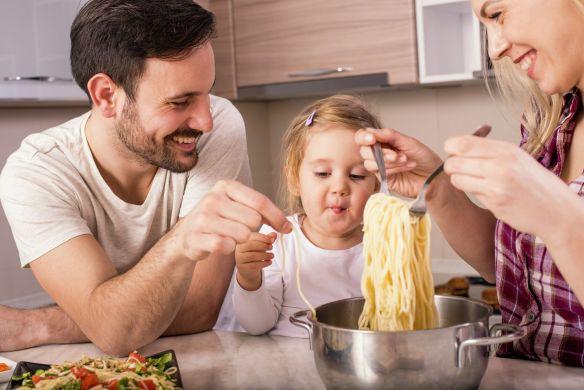family making spaghetti