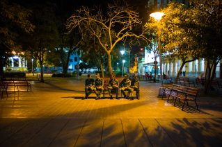 Cuban Soldiers on a bench in the main park in the city center of Santa Clara. It's 4 o'clock in the morning and the soldiers are waiting to take part in the funeral ceremony. Their duty is carry out security checks. There was a large military presence all along the funeral route, for fear of an attack. Santa Clara, Cuba. 1 December 2016.