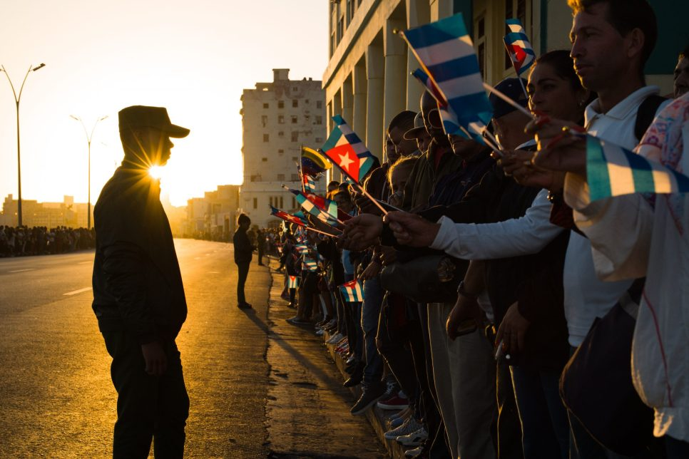 "A Cuban soldier observes the crowds of people waving Cuban flags at the funeral procession carrying the ashes of the ""Lider Maximo"", Fidel Castro, on the Malecon in Havana, Cuba, 30 November 2016. The former President of Cuba died of natural causes on 25 November 2016. He had held on to power for almost 50 years, until 2008 when he stepped down due to illness. Many Cubans feel a personal attachment with their leader, who is considered as a father of the nation by many."