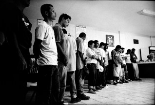 Illegal migrants wait for dinner at the Casa del Migrantes, migrant shelter, run by a church in Reynosa, a border town between U.S. and Mexico. Many illegal migrants stay at Casa del Migrantes before crossing the border to the U.S.