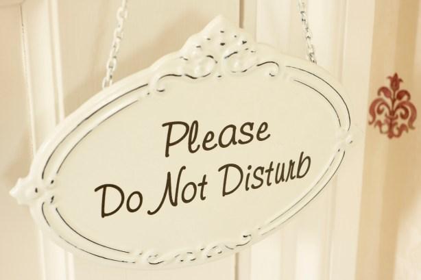 Do Not Disturb Sign Hanging On Door