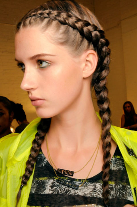 3. Crown Braids Crown braid pigtails: sporty and chic.