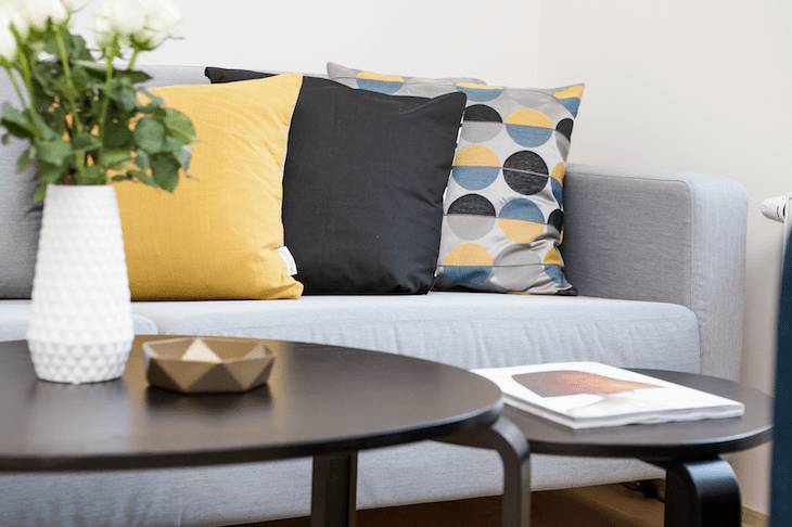 Flipped Image of a Sofa, Coffee Table, and Pillows