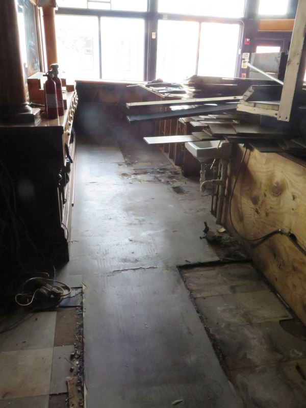 Today I removed the top layer of flooring from behind the bar.