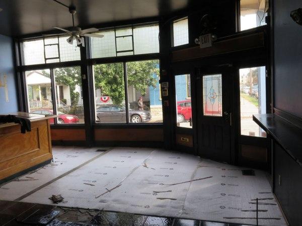 The front flooring of the storefront. Plastic floor – gone. Tile.... ugh.