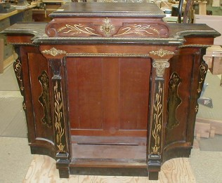 A cabinet by the French-born 19th century New York cabinetmaker Alexander Roux.