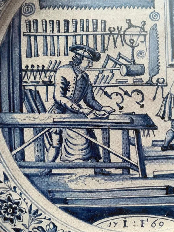 An image of a woodworker at a workbench, perhaps using a travisher or scorp.