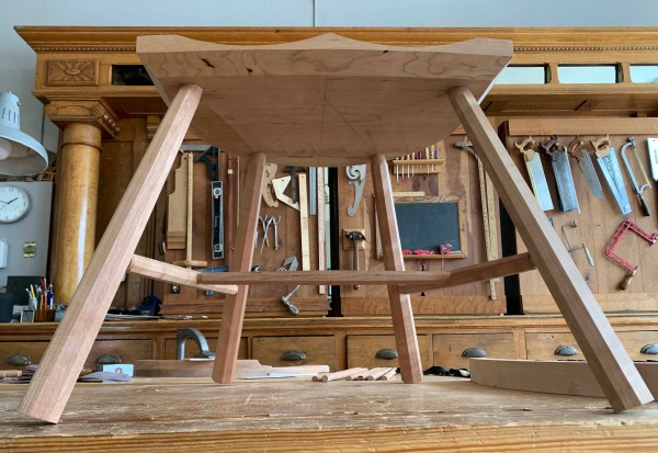 underside of a stick chair in cherry