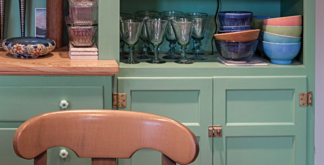 fold-back hinges on green cabinets
