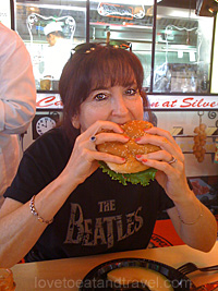 Alana eating a hamburger at Joe's Cable Car Restaurant - best burger in San Francisco, CA!