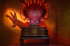 A painted dragon overlooks the throne of the Qing emperor