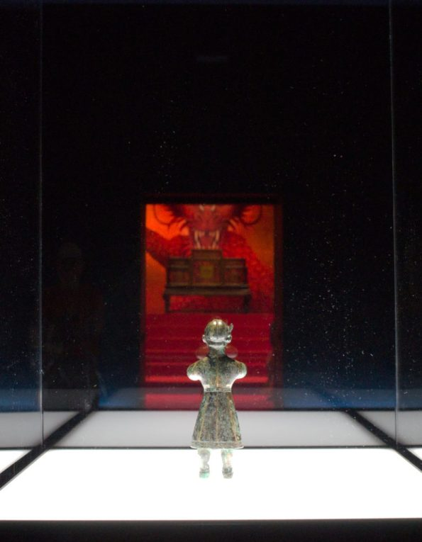 Chinese figurine overlooking throne room