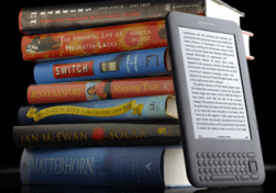 A Stack of Books and an ereader