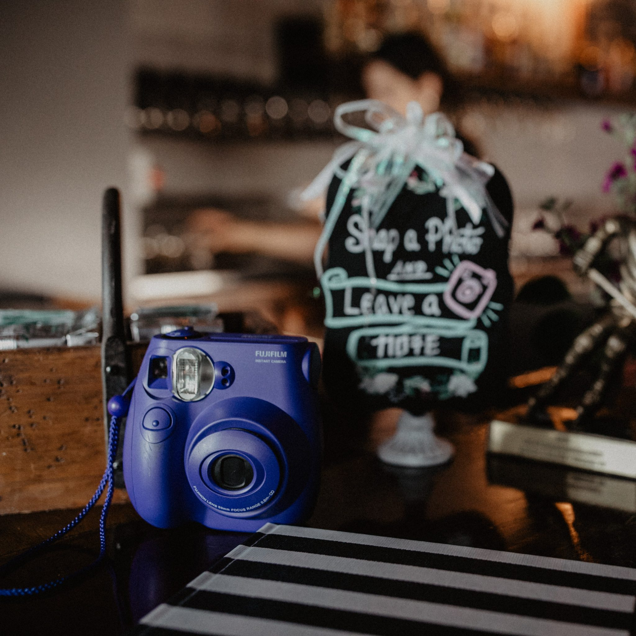 Lulu xPress wedding guest book with Instax film camera at Southern wedding reception