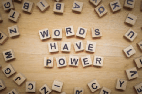 Scrabble letters spell 'Words Have Power'