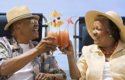 Couple toasting with tropical cocktails