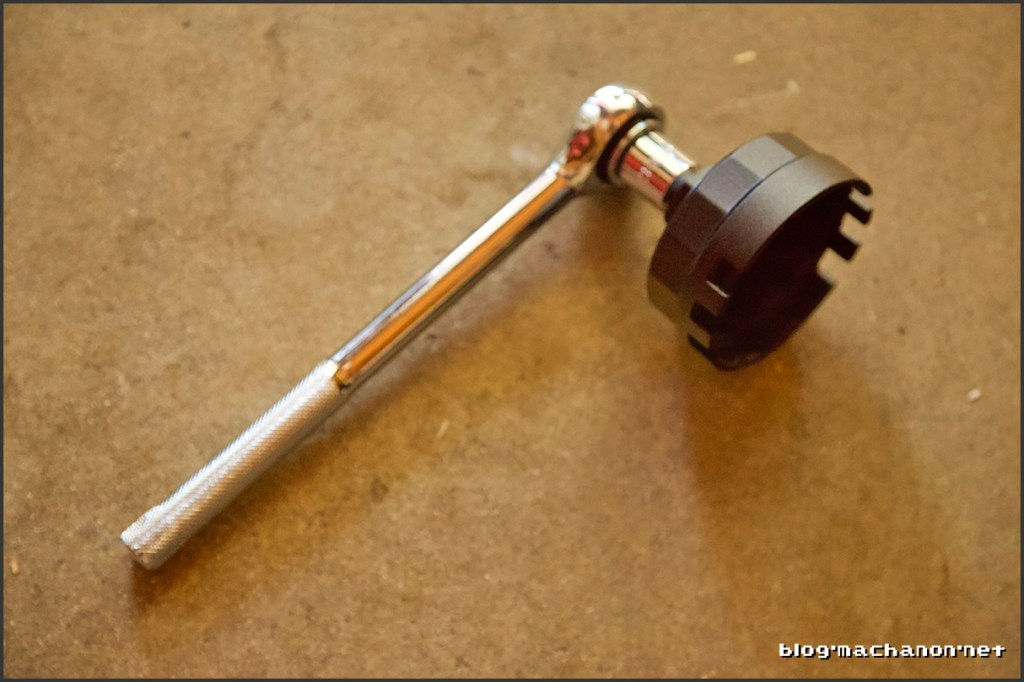 Attach oil filter wrench onto a heavy duty ratchet or breaker bar