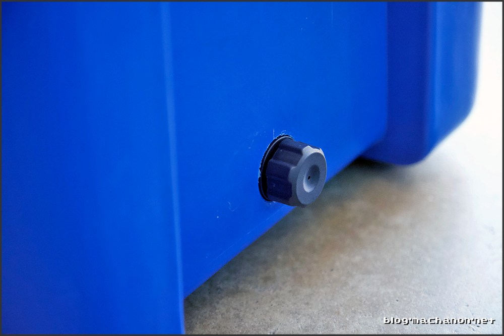Excess molding material around drain plug on the rotomolded cooler by Blue Coolers.