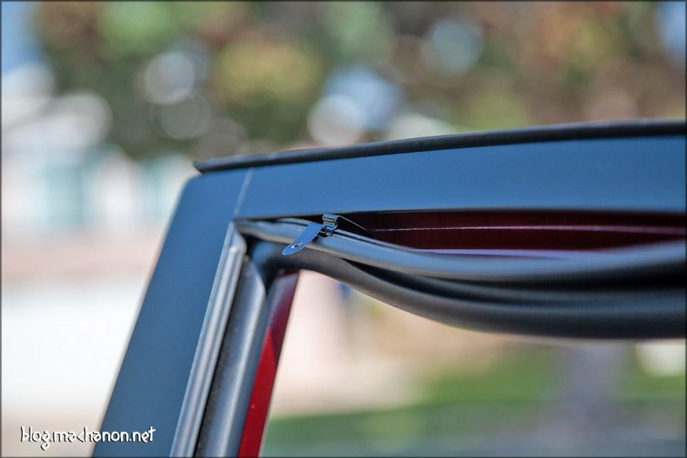 Window visor support bracket.
