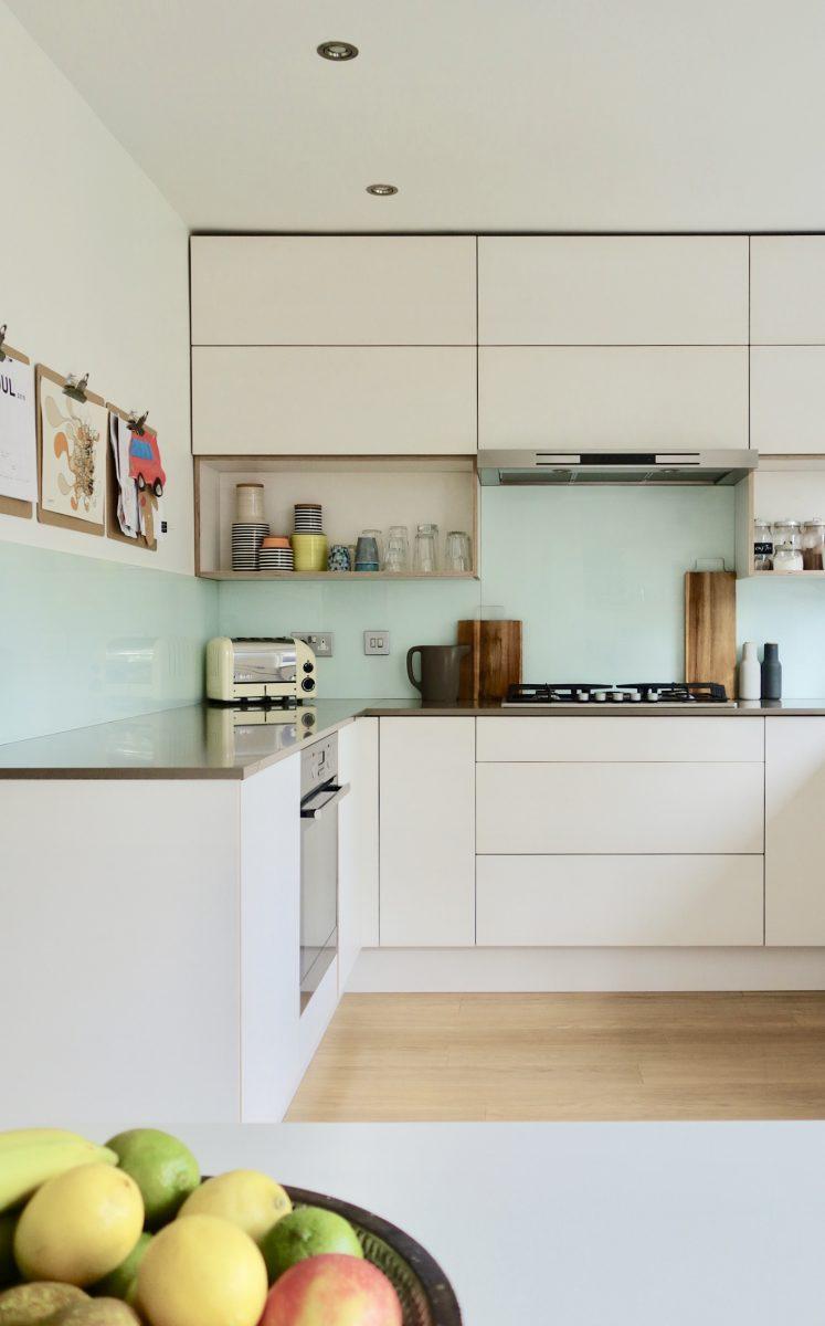 Handleless white birch plywood kitchen