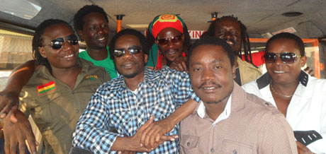 The whole band together with Anthony Makondetsa and band manager Man Ray Harawa in the back.