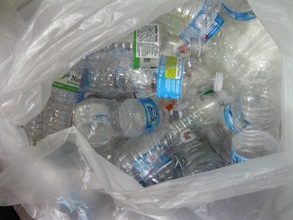 Gathering materials: empty water bottles (abundantly collected by the school!)