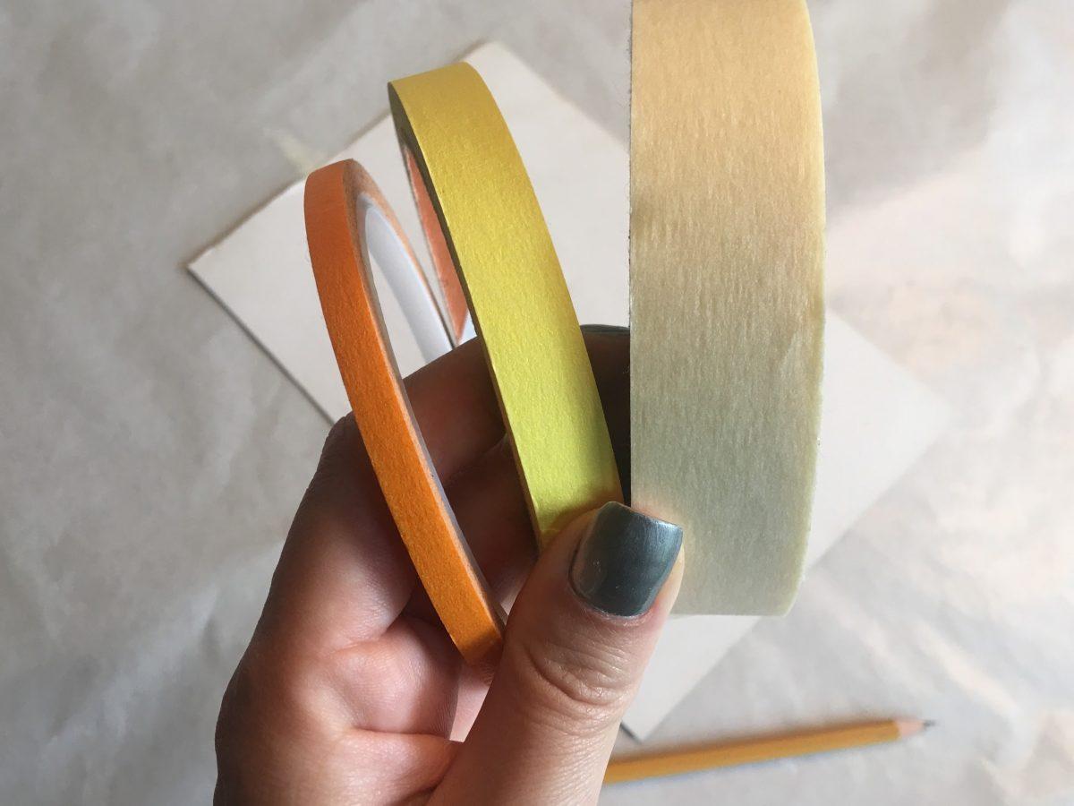 Three different small rolls of tape