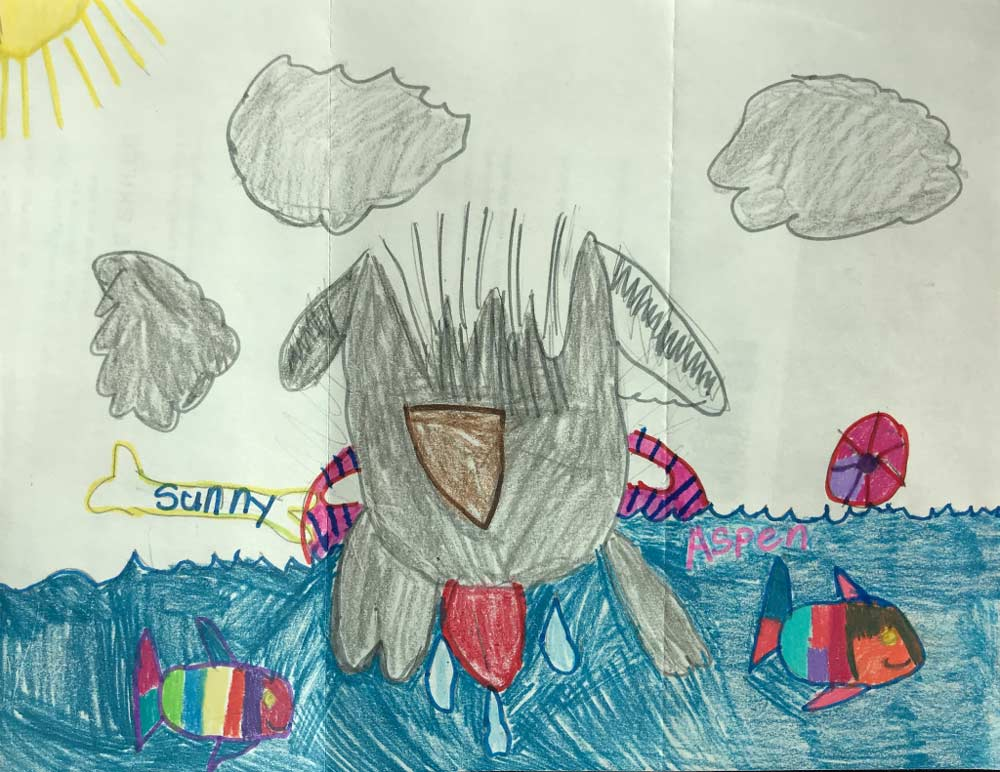 Child's replica of Sunny in a pool floatie in the ocean surrounded by fish